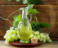 Jugful with grape seed oil Stock Images