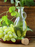 Jugful with grape seed oil Royalty Free Stock Photography