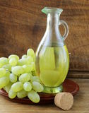 Jugful with grape seed oil Royalty Free Stock Photos