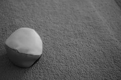 Juggle ball on grey carpet black and white photo. Concept Stock Photo