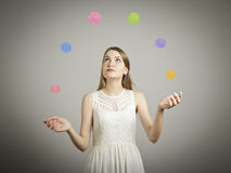 Juggle. Balls. Girl in white is juggling. Concentration concept Royalty Free Stock Image