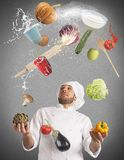 Juggle while cooking Royalty Free Stock Photo