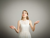 Juggle. Girl in white is juggling. Concentration concept Stock Photography
