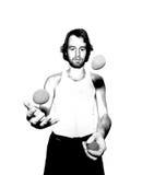 Juggler. Young male juggler, throwing balls Stock Images