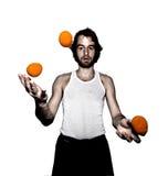 Juggler. Young male juggler, throwing balls Royalty Free Stock Images