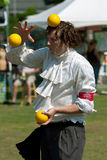 Juggler Balances Ball On Head At Festival Stock Photos
