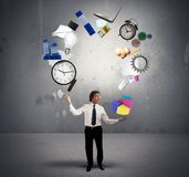 Juggler businessman. A Juggler businessman play with business objects Royalty Free Stock Photos