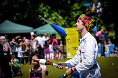 Juggler. Juggling at outdoor event royalty free stock photography