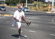 Juggler juggling in traffic in South Africa. stock photos