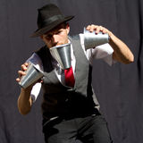 Juggler playing with three cups. Royalty Free Stock Photos