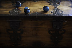 Juggler's balls on his wooden chest Stock Images