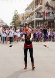 Juggler shows her art for the viewers on the street Stock Images