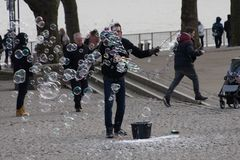 Juggler with soap bubbles. A juggler delights young and old with soap bubbles Royalty Free Stock Photography