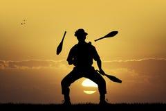 Juggler at sunset Stock Images