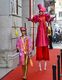 Juggler and Woman on Stilts Royalty Free Stock Photo