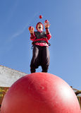 Juggling above the ball Royalty Free Stock Photography