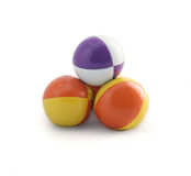Juggling Balls. Pyramid of juggling balls on white background Stock Photos