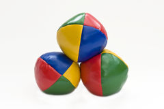Juggling balls. Three juggling balls on a white background royalty free stock photos