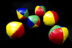 Juggling balls in bright colors Stock Images