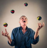Juggling with balls. Elderly man juggling with balls Royalty Free Stock Images