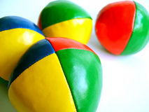 Juggling balls on white Royalty Free Stock Photography