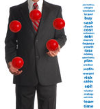 Juggling Businessman. Business Concept for time managemant, multitasking, confidence, etc.  Includes spherized business words that match the ball's contours for Stock Photography