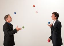 Juggling businessmen Royalty Free Stock Images
