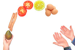 Juggling and catching food collage. Womans hand tossing food in the air and mans hands catching it isolated on white.  Juggling and catching food collage concept Royalty Free Stock Image