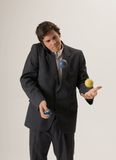 Juggling while chatting on mobile phone Stock Image