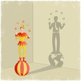 Juggling clown casting shadow of businessman Royalty Free Stock Photography