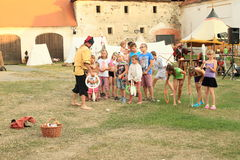 """Juggling competition for kids. Juggler competition for kids arranged by Czech famous juggler Zdenek Vlcek at """"Conquest of water castle Svihov"""" (Czech Republic Royalty Free Stock Image"""