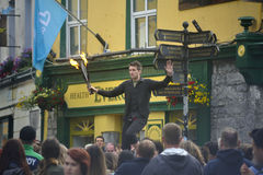 Juggling with fire on a unicycle. Jungler on Shop Street in the Galway Art festival 2016 Stock Photo
