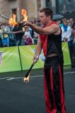 Juggling flaming batons Royalty Free Stock Photo