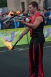 Juggling flaming batons Royalty Free Stock Photos