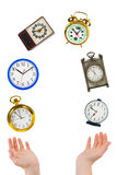 Juggling hands and clocks Royalty Free Stock Photos