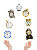Juggling hands and clocks Stock Images