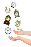 Juggling hands and clocks Stock Photography