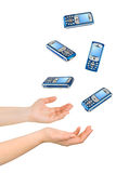 Juggling hands and phones Royalty Free Stock Image