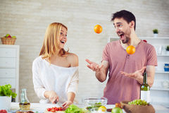 Juggling in the kitchen Stock Photography