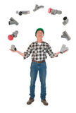 Juggling plumber with PVC tubes Royalty Free Stock Photo