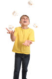 Juggling Presents. A cheerful child dressed in plain t-shirt and denim jeans juggling small giftboxed presents Stock Images
