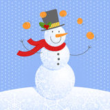 Juggling snowmen Stock Images