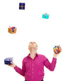 Juggling with some colorful gifts. A business person juggling with some colorful gifts Royalty Free Stock Photo