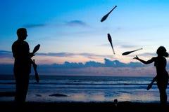 Juggling at sunset Stock Photos