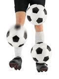 Juggling three soccer balls with the feet. Skilled soccer player shows awesome juggling of three balls on his feet Stock Images