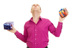 Juggling with two colorful gifts. A business person juggling with two colorful gifts Royalty Free Stock Images