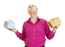 Juggling with two colorful gifts. A business person juggling with two colorful gifts Stock Images