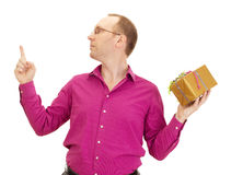 Juggling with two colorful gifts. A business person juggling with two colorful gifts Stock Photography