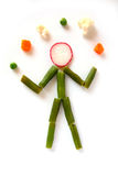 Juggling vegetables Royalty Free Stock Image