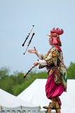 Juggling woman in a chicken suit. A woman in a chicken costume juggles flaming sticks at an outdoor fair in Michigan USA royalty free stock photos